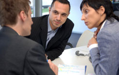 Small business directors in a meeting with a car leasing broker