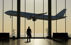 Stranded businessman watches plane take off