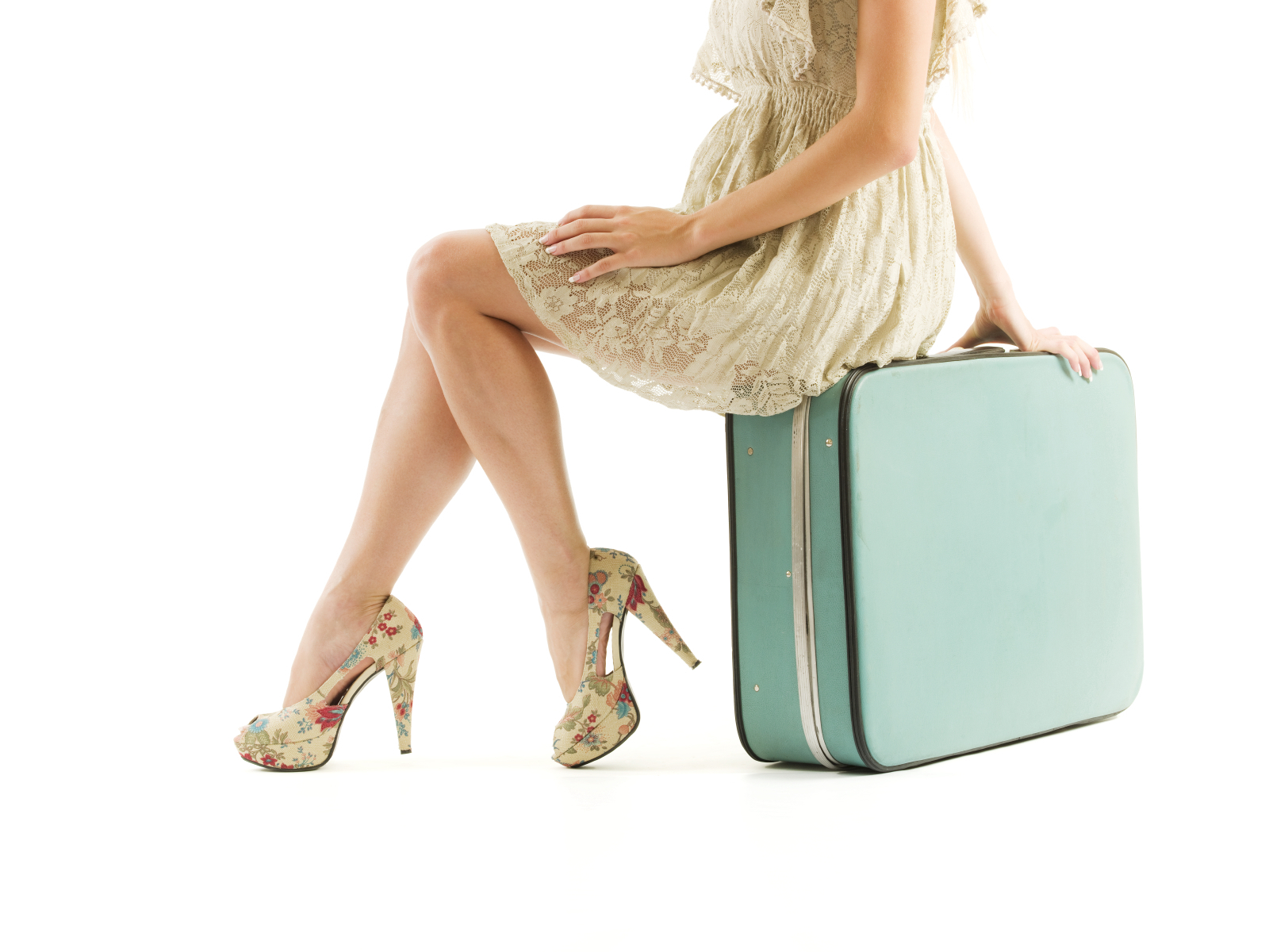 Classy woman with suitcase ready for travel