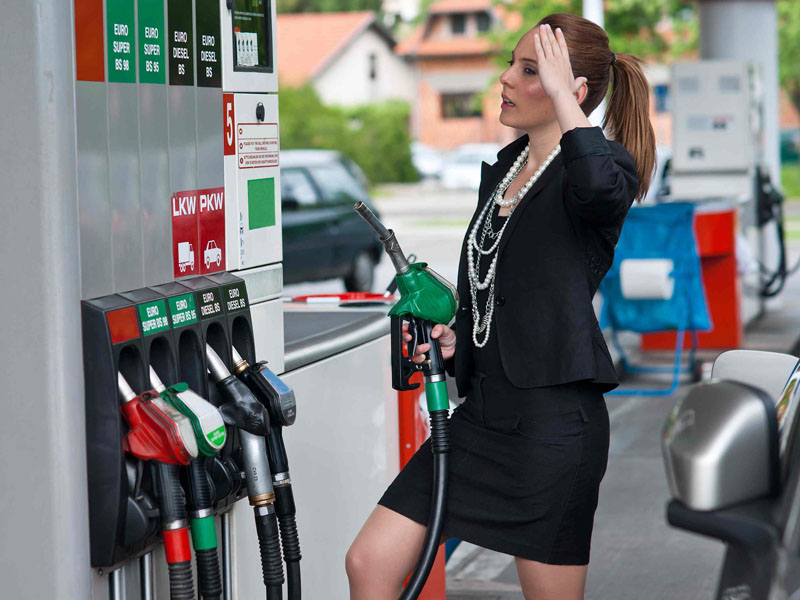1069_Business_Woman_At_Fuel_Pump