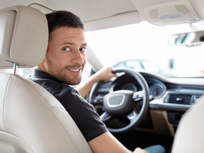 Man, sitting, in , the , interior, of, an, Audi