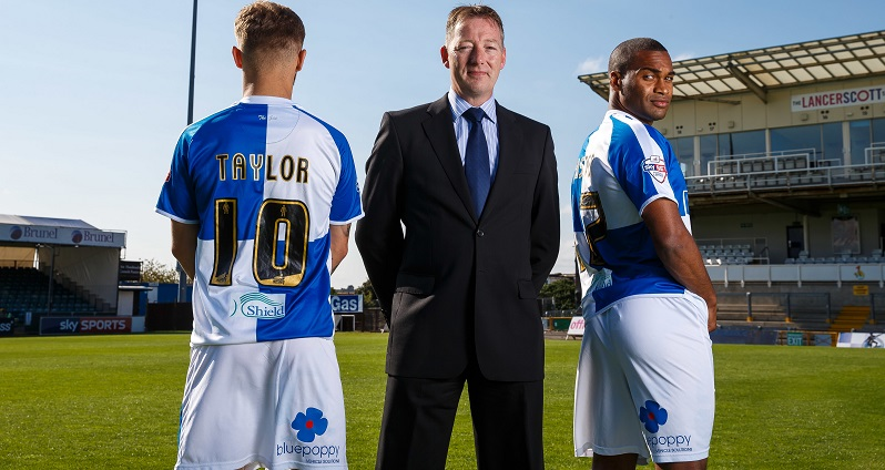 BluePoppy MD Andrew Starr with Bristol City scorers Matty Taylor and Jermaine Easter sporting the BluePoppy shorts. Picture: Rogan Thomson/JMP - 07966 386802 - 07/09/2015 - FOOTBALL - Memorial Stadium - Bristol, England - Bristol Rovers Team Photos.