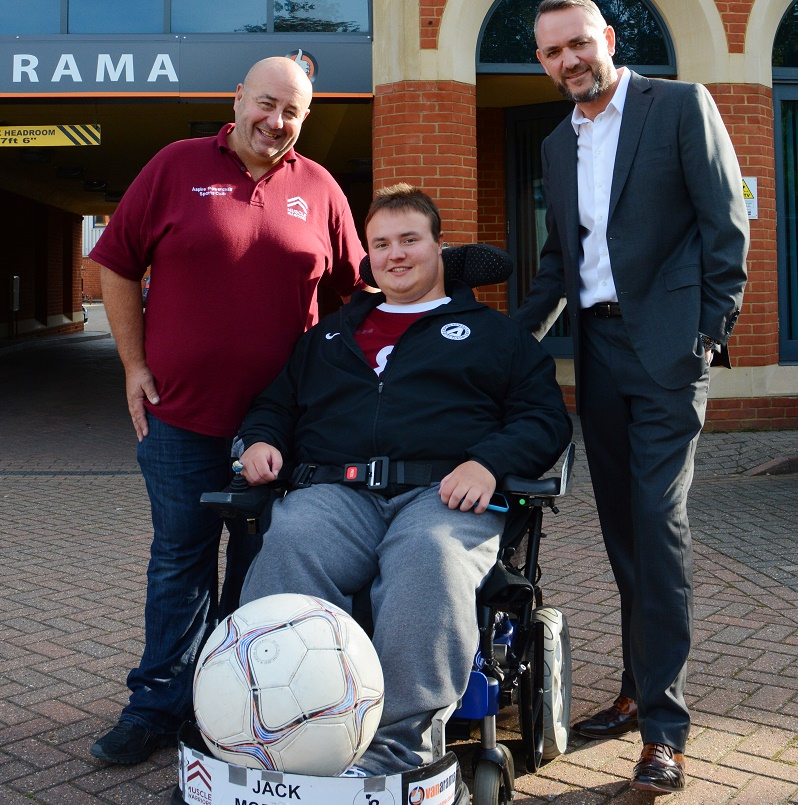 Vanarama managing director Andy Alderson, right, with Philip Morrell (left) and Jack Morrell in his Powerchair