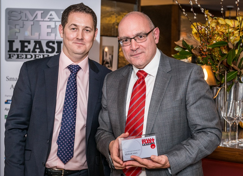 Ty Smith of Arval (left) presents Jon Gilbert of Vanarama with the marketing award