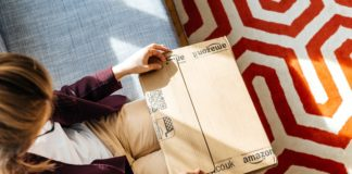 Woman opening Amazon package photo Hadrian Shutterstock
