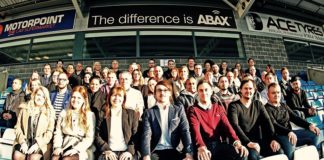 Chief executive Chris Miller (red jumper) with the ABAX UK team after their move to new offices at the ABAX Stadium business centre this year - now two acquisitions strengthen ABAX in Europe