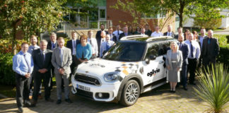 Ogilvie Fleets Sheffield office employees surround a specially liveried Mini celebrating 10 years of delivering service excellence in England