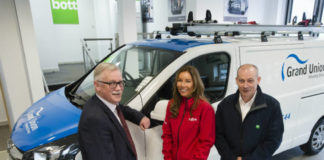 GUHG Health, Safety and Business Services Manager Richard Pearce (left), with Ogilvie Fleet Director of Sales Jo Clark and Bott Sales Director Stephen Turner in front of one of the new Vauxhall vans on the fleet.