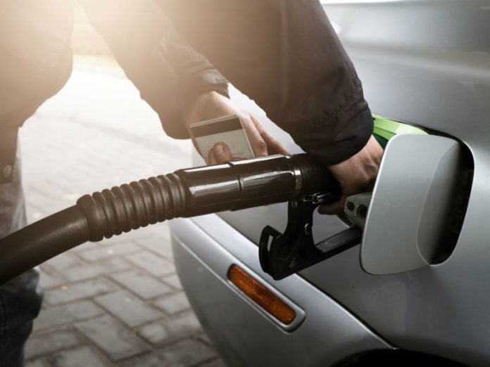 Man filling up company car with fuel