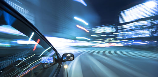 The car moves at great speed at the night