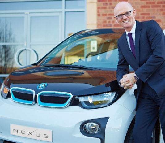 David Brennan CEO Nexus Vehicle Rental with car